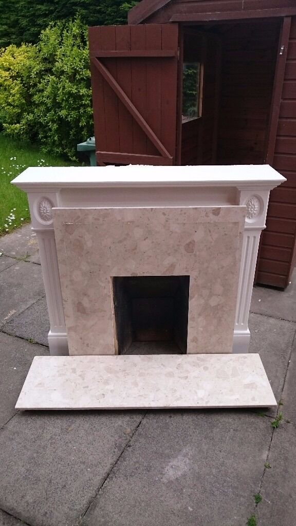 White wooden fireplace and solid Italian marble hearth