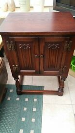 small two door carved cabinet