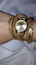 Gold and leather wraparound Geneva quartz watch