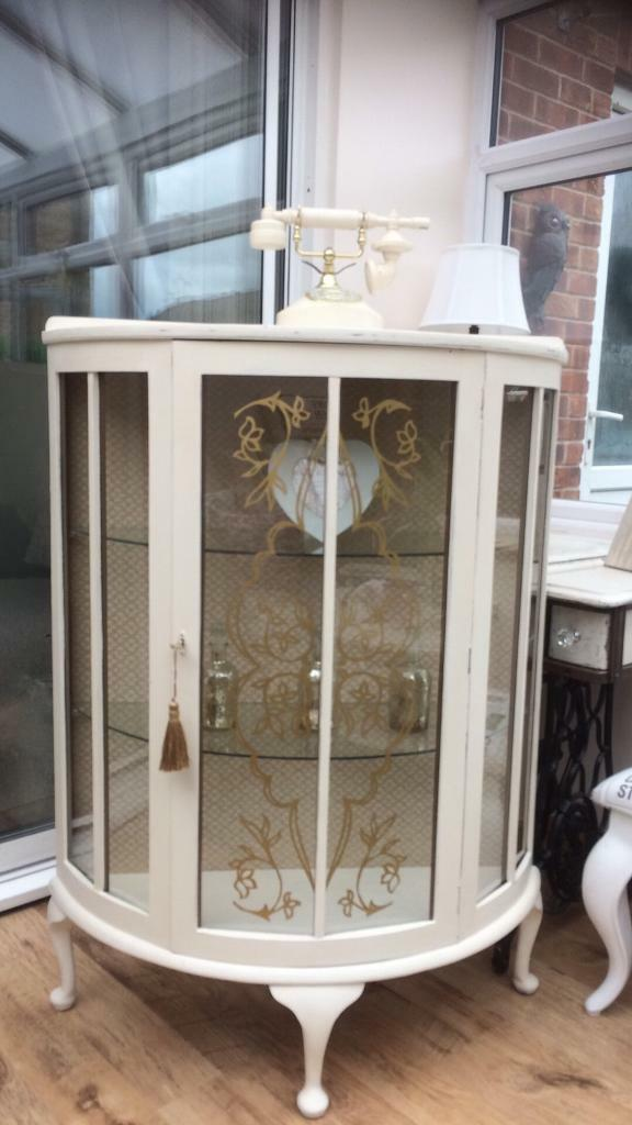 Beautiful China cabinetin Long Eaton, NottinghamshireGumtree - Stunning half moon cabinet. Painted in Annie Sloan original chalk paint, sanded back to reveal a little distressing in places, then clear waxed to seal.The inside back panel has been recovered in a beautiful gold and cream heavy material which really...