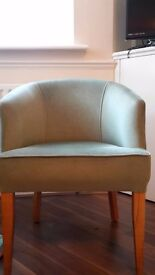 Small green velour type armchair