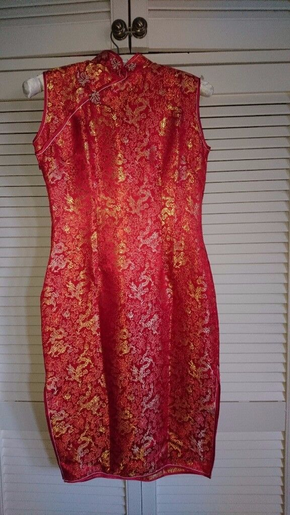 Red Chinese style midi length dress with dragons. Suitable for sizes 10-12