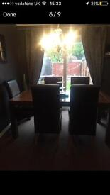 Solid dining table and 6 high back chairs