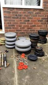 Body building equipment - free weights, benches, punching bag, bars etc