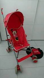 Red Disney Mini Mouse MOTHERCARE stroller with red KOODI rain cover and Summer sun sgade