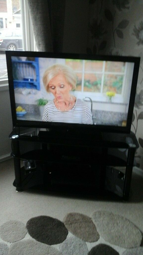 Freeview Technika TV and glass stand.