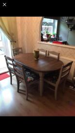 Dulco dining room table. Extendable. Solid pine. Could do with a repaint. 6 chairs included