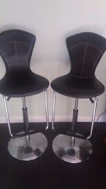 Two Bar Stools - black leather and chrome