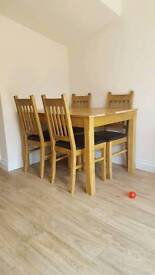 Dining Table + 4 half leather chairs