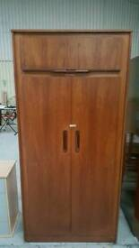 Solid wardrobe in good condition can deliver 07808222995