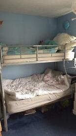 Metal triple bunk bed with mattresses