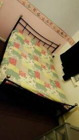 Black double bed frame and mattress