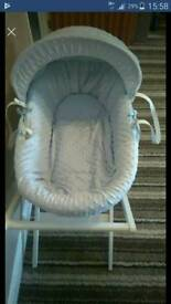 Moses basket baby blue.