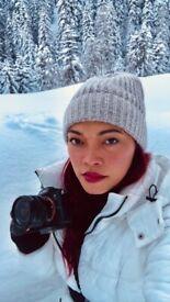Creative female photographer, videographer, video editor, and visual content creator
