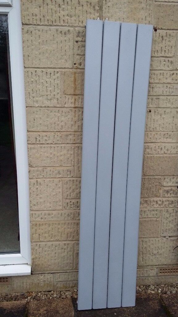 Silver flat panel vertical radiator