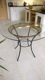 Round glass topped dining table