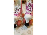 Girls pink and white roller boots for sale.