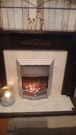 Brown fireplace and surround including electric fire