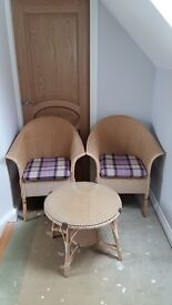 Lloyd Loom table and chairs in excellent condition. Ideal for a conservatory or sun room.