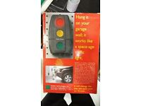 Car parking aid hang it in your garage wall;it works lika a space - age traffic light.