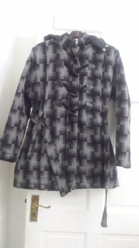 Ladies coat black and gray with hood size medium . in very good condition wasn't used a lot used.
