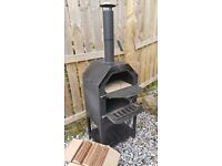 Pizza oven for sale, stone baked, wood fired. Only a year old!