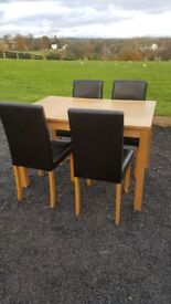 Table with 4 leather chairs