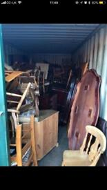 Container and room full of shabby wheel furniture