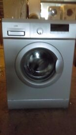 LOGIK silver WASHING MACHINE new ex display which may have minor marks or blemishes.
