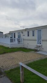 Caravan holiday rental with 3 bedrooms decking and own drive by beach lovely friendly site