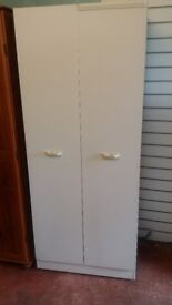 Solid wardrobe in very good condition.