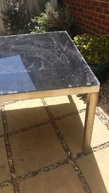 Black glass top garden table
