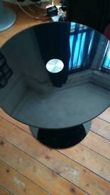 Small black round glass table