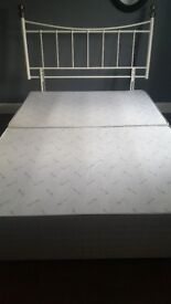 Double divan bed with off white metal headboard