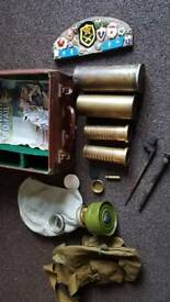 Case of military stuff inc gas mask & shells