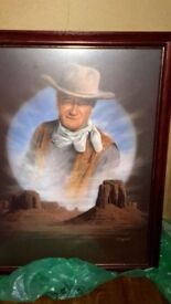 Large print of John Wayne in Monument Valley nicely framed with non glare glass.