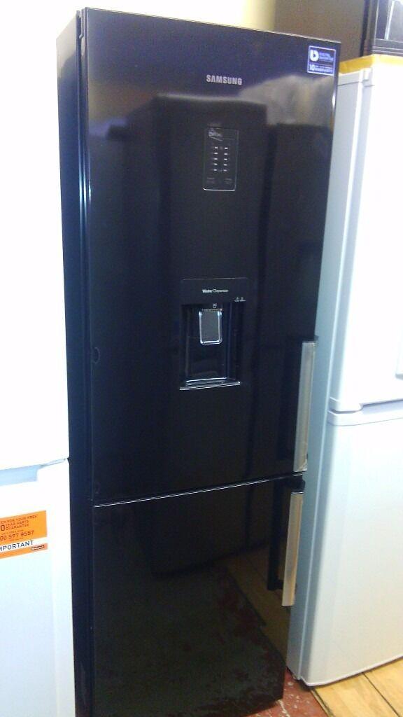 SAMSUNG black With water dispenser fridge freezer, new Ex display