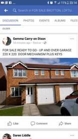 Up n over garage door plus mechanism