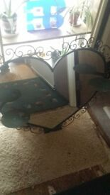 Large heart shaped mirror with two sconces.