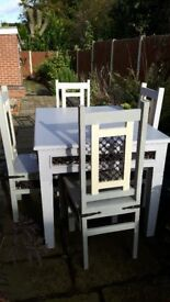 Attractive solid wood dining table and 4 chairs