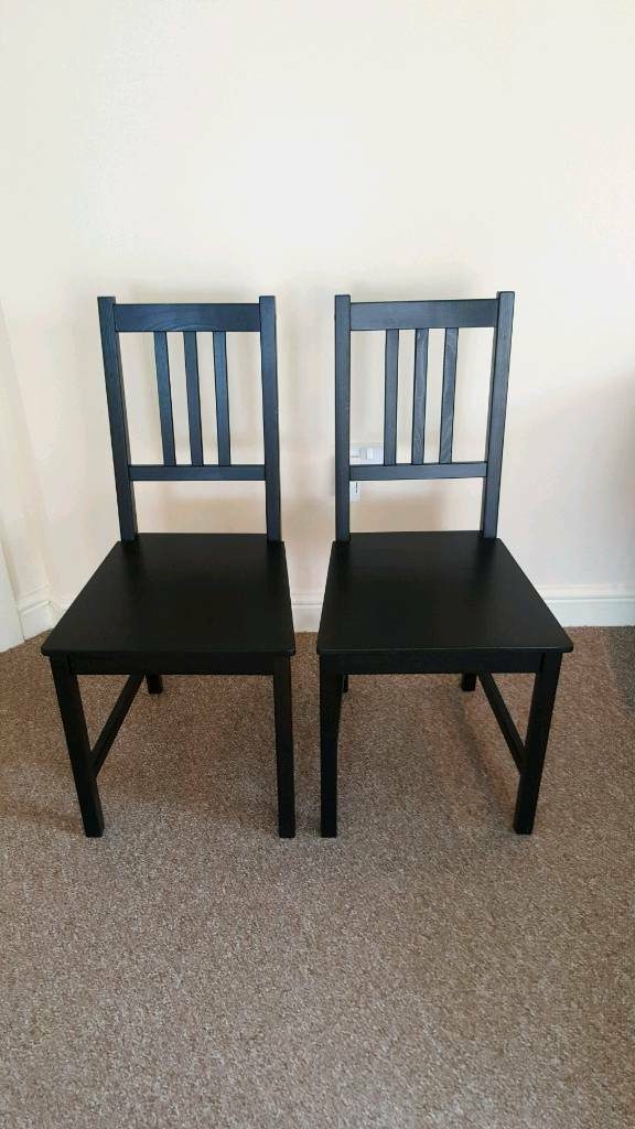 Pair of black Ikea dining chairs