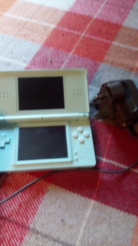 Nintendo DS lite aqua blue with charger and game