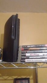 PS3 with 2 controllers and 6 games for sale