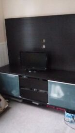 Dark brown tv unit with drawers and shelves with frosted glass