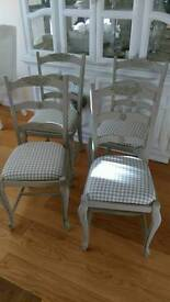 Four solid oak French dining chairs painted in grey. Shabby chic