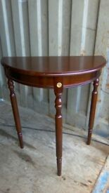 Small reproduction demilune console table