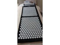 Bed of Nails - therapeutical acupressure mat.