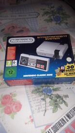 Mini nes with 30 built in games...mint condition