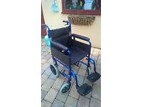 Wheelchair, foldable, small wheels, brakes, nearly new, folds for easy stowage to travel