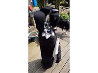 SOLD. full set of golf clubs inc bag and balls.